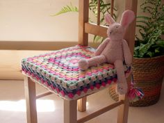 I would add a cushion, and I like the sides hanging down, maybe add elastic to hold it on the chair more firmly