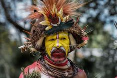 The Huli Tribe currently has a population of around people and lives in the Tari Basin in the highlands of Papua New Guinea Blue Mountain Coffee, Skeleton Warrior, Tattoo Process, Ready For Marriage, Facial Tattoos, New Britain, Tribal People, Powerful Images, Exotic Places
