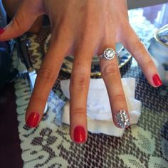 Wedding bling finger...you should do this, Anne!  Only do french manicure nails for the other fingers instead of red polish!