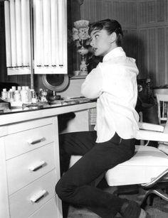 Audrey Hepburn in her dressing room at the Sabrina movie studios, 1954.