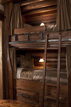 homemade bunk beds made of brown wood with three white . Homemade bunk beds made of brown wood with three white beds and a . Rustic Bunk Beds, Cabin Bunk Beds, Log Cabin Bedrooms, Triple Bunk Beds, Built In Bunks, Bunk Rooms, Cool Bunk Beds, Bunk Bed Designs, Log Cabin Homes