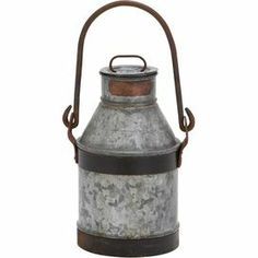 "Bring rustic appeal to your entryway or master suite with this metal milk can decor, showcasing a loop handle and gray finish.  Product: Milk can decorConstruction Material: MetalColor: Gray Features: Loop handleDimensions: 13"" H x 9"" W x 7"" D Note: Not recommended for outdoor useCleaning and Care: Wipe with dry cloth"