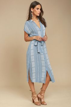 We are so glad we found the I'm the One Blue and White Striped Shirt Dress! Lightweight woven rayon in a blue and white striped pattern falls from a collared neckline into a button-up bodice and short dolman sleeves. Tying waist sash and midi silhouette with side slits.