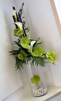 Awesome floral arrangement with white calla lilies and green anthurium