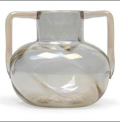Marie Kirschner (1852-1931), A two-handled vase, Designed in 1903/04, executed by Lötz Witwe, Klostermühle, clear glass with optical diagonal grooves, iridescence, the underside with wheel-cut monogram MK, height 16.5 cm,