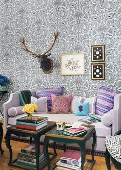 Mellow patterned wallpaper & soothing colors are an invitation to rest in this living
