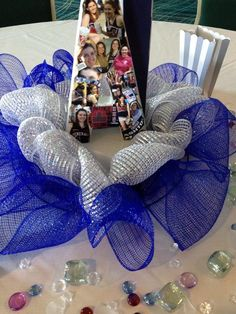 Cheer Banquet Table decorations - each girl's first initial covered with a collage of pics of them throughout the season. Everyone loved them and took home their personal memory!