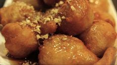 The very best traditional Loukoumades recipe (Greek donuts)! Loukoumades are little fluffy sweet honey balls, deep fried to golden and crispy perfection. Greek Sweets, Greek Desserts, Greek Recipes, Churros, Greek Donuts, Honey And Cinnamon, Cinnamon Syrup, Greek Dishes, Toasted Sesame Seeds