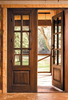 These French patio doors were made using salvaged lumber. They feature sidelights with operable shutters and bug screens. French Doors Bedroom, French Door Curtains, French Doors Patio, Patio Doors, Wood French Doors Exterior, French Patio, Entry Doors, Front Door Design, Window Design