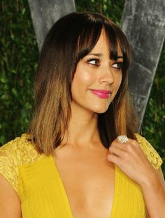 'Who, Me?': Actress Rashida Jones gives a coy smile at the 2012 Vanity Fair Oscar Party hosted by Graydon Carter at in West Hollywood, Calif. But that canary yellow dress is anything but shy.
