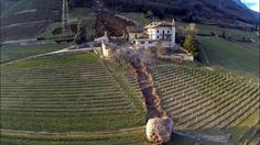 Back in February... Vineyard CUT in HALF by a GIANT Rolling Stone, off the Mountain Termeno, South Tyrol #Italy #wine