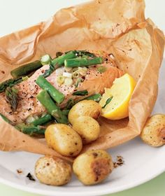 Baked Salmon in parchment paper --- had this for dinner this weekend and it was phenomenal!!! Pair with a champagne Dijon beurre blanc sauce!! Amaze!