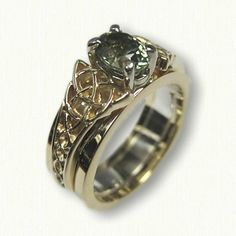 14kt Yellow Gold Celtic Circle Trinity Knot Reverse Cradle set with a 1.26ct Oval Green Sapphire