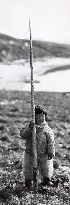 Inuit boy with narwhal tusk. Maynard Owen Williams/National Geographic Creative