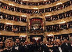 La Scala opera house in Milan, Italy.. see the box seating with the red drapes, that's where we sat.  We were treated like royalty.  It was awesome