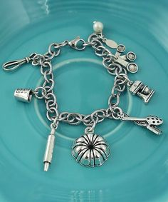 "The home cookin' charm bracelet includes 7 adorable cooking themed charms and makes the perfect gift the amazing bakers in our lives, or it can be just for you to show off your love for baking!! <br /> <br />This bracelet is finished on an adjustable 8"" stainless steel chain with a freshwater pearl."
