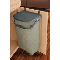 The Hidden Recycler attaches to the inside of a cabinet door to collect recyclables out of sight and keeps your counters clear. The bag is durable, machine washable, and made of recycled material. || Rubbermaid 5 gal. Hidden Recycling Bin