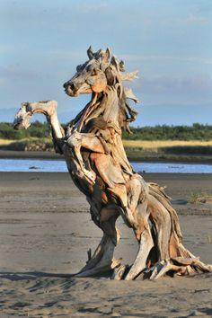 Driftwood horse raring up