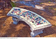 Concrete bench with mosaic tile top