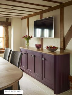 The plum media unit in the dining area of this kitchen design contrasts from the cream kitchen, helping to distinguish different zones. Kitchen Units, Open Plan Kitchen, New Kitchen, Kitchen Cabinets, Kitchen Ideas, Kitchen Colour Schemes, Kitchen Colors, Kitchen Design, Shaker Style Kitchens