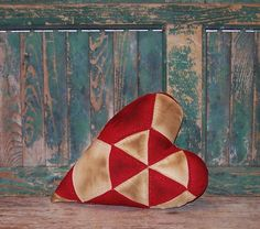 Heart pillow made from antique quilt, lightly grunged. Handmade by Prairie Primitives Folk Art in California.