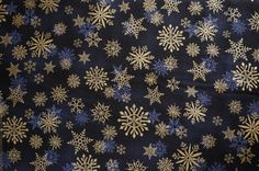 Snowflakes (dark blue background); sold by the yard