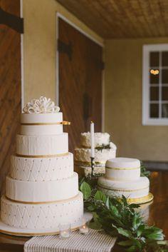 White and gold wedding cakes: http://www.stylemepretty.com/washington-weddings/2014/10/29/rustic-villa-wedding-inspiration/   Photography: Melissa Leith - http://melissaleith.com/