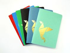Notebook with golden origami details