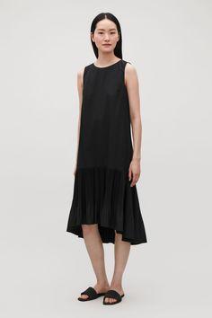 78cc6b9741dc See more. PLEATED SLEEVELESS DRESS - Black - Dresses - COS FR Cotton Dresses
