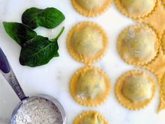 An easy-to-follow guide on making homemade ravioli filled with fresh ricotta cheese and organic baby spinach.