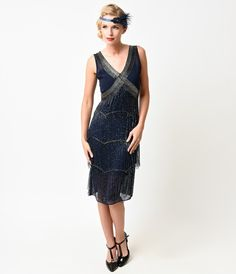 Arriving in full Gatsby glory, this exquisite chiffon flapper dress is a Unique Vintage original, hand beaded with stunning symmetrical deco cross beading complemented by subtle scalloped levels. A sleeveless, semi-fitted silhouette is authentic to the ro