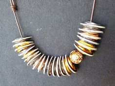 Nespresso jewellery - gold and brown with gold bead Nespresso, Gold Jewelry, Jewlery, Nescafe, Capsule, Bangles, Bracelets, Gold Beads, Recycling