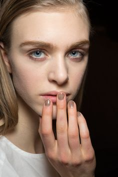 For a sheer black manicure, Deborah Lippmann mixed eight drops of Fade to Black with a base coat.   - HarpersBAZAAR.com