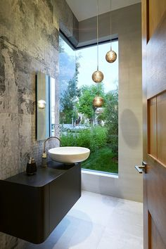 La Jolla Residence by Adeet Madan. Small bathroom, wall treatment, view window.