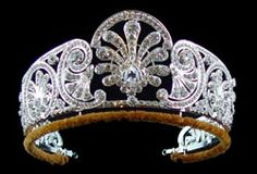 British: Queen Mary's Honeysuckle Diamond Tiara - c. 1914 - given to her daughter-in-law, Princess Alice Duchess of Gloucester. Now worn by the current duchess, Birgette. It has 3 interchangeable center medallions: the diamond honeysuckle,  a pink topaz and an emerald surrounded by diamonds.