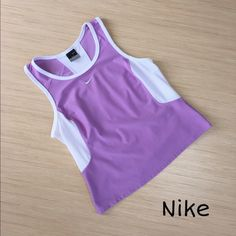 Nike Dri-fit Tank Top Size Medium Look super cute getting your sweat on with this size medium, lavender Nike Dri-fit tank top. It is made of 92% polyester and 8% spandex (exclusive of decoration). It has white mesh on both sides with a mesh strip running down the back. It is gently worn but is in great condition! Nike Tops Tank Tops