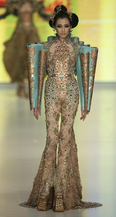 GUO PEI this body suit and structural arm decor is part of my afrofuture