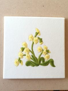 Embroidered picture of primroses by Ruth O'Leary