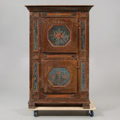 CUPBOARD, dated 1791 and 1843, Sweden. SKÅP, allmoge, daterat 1791 samt 1843. Bemålat trä. Två skåpsdörrar med dekor av blomster och bakomliggande hyllinredning. Längd 124 cm, bredd 48 cm, höjd 187 cm.
