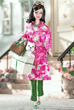 Barbie's Best-Ever Designer Collaborations: Kate Spade, 2003.  In addition to her very bright outfit, Kate Spade's Barbie carries not one but two Kate Spade purses; one for her and one for Kate's beloved dog, done in plastic form. Aw.