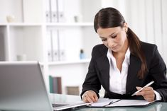young-businesswoman-working-on-documents-175524985-577f95f15f9b5831b5350d9a.jpg (5616×3744)