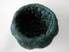 Hitomi Hosono - 'a mangrove bowl', 2014 ~ 18cm h x 26 cm She wanted to make pieces using the sprigging technique, but to move away from the traditional use of sprigs solely as ornament, and to attempt to work with ceramic sprigs in a new and sculptural way. After extensive experimentation she created two new ways to use the sprigging technique. One was to cover the entire surface of a shape with sprigs; the other was to construct a sculptural object solely out of many layers of sprigs.