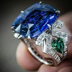 Pure #ringporn From @realm_of_jewellery - Exceptional craftsmanship and unique design captured elegantly in this 23 carat sapphire beauty by Maison Tabbah @maisontabbah