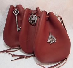 Brown Leather Drawstring Pouch with Pewter Accent / Dice Crystal Medieval Renaissance SCA Pouch / Dragon Celtic Wolf Pentacle Key Lion Bag by DragonStarCreations1 on Etsy https://www.etsy.com/ca/listing/191932079/brown-leather-drawstring-pouch-with