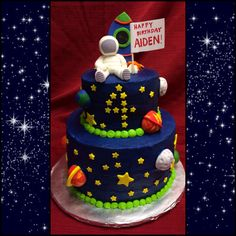 Space themed cake with astronaut sculpture