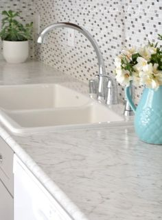 The countertops are Formica Carrara Bianco in the Ideal Edge. It amazes me how far laminate countertops have come! You can get the look of marble for sooooo much less plus they're low maintenance and easy to clean. Kitchen Remodel Countertops, White Kitchen, Marble Bathroom, Cool Kitchens, Replacing Kitchen Countertops, Gray And White Kitchen, White Kitchen Remodeling, Calcutta Marble Bathroom, Diy Kitchen
