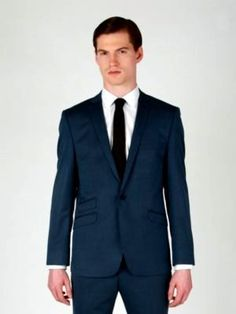 Natty suit by Ben Sherman. I prefer Sherman's suits and outerwear to most of his shirts and pants. There are exceptions, of course, but this Mad Men-esque ensemble rocks.