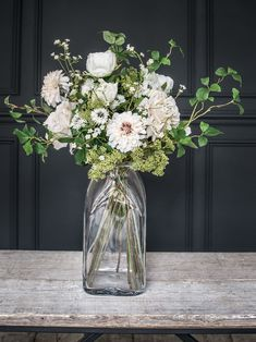 love these winter whites and blush pink dahlia faux flowers in large glass jar by philippa craddock. Perfect for creating long-lasting christmas flower arrangements. Click through for creative DIY christmas holiday flower ideas you'll love. Rustic Flower Arrangements, Christmas Flower Arrangements, Artificial Flower Arrangements, Vase Arrangements, Christmas Flowers, Winter Flowers, Rustic Flowers, Fake Flowers, Artificial Flowers