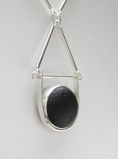 The large rare black sea glass is genuine. It was found on a beach in England and is no back bezel set. The pendant is handmade of 1/2 round