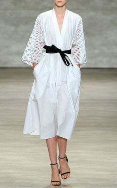 This white **TOME** kimono style dress features a cotton construction with eyelet sleeves.